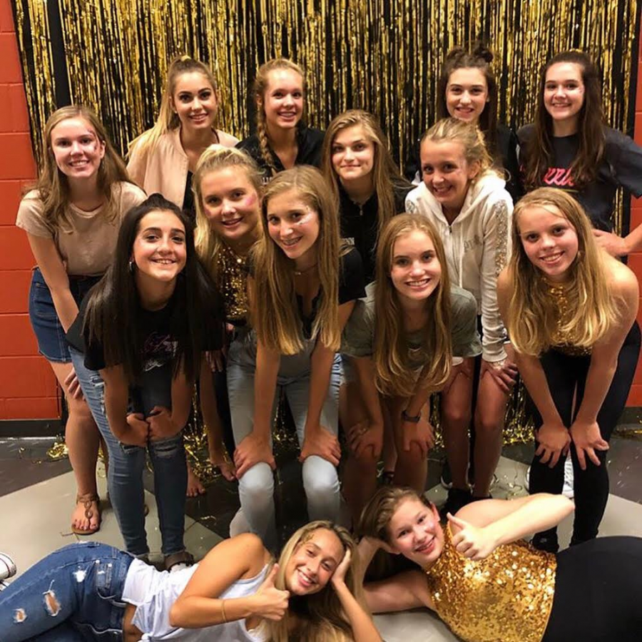 The Dazzler Dance Team poses for a picture following the success of their first school dance.