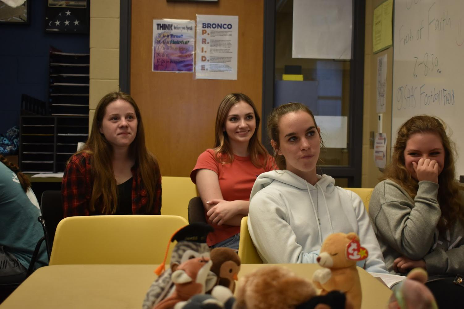 Gracie Campos, Ashley Carlisle, Porscha Stocker, and Kyra Fuchs, 9, all laugh while listening to Paul Young's, History teacher, lesson on Sept. 25.