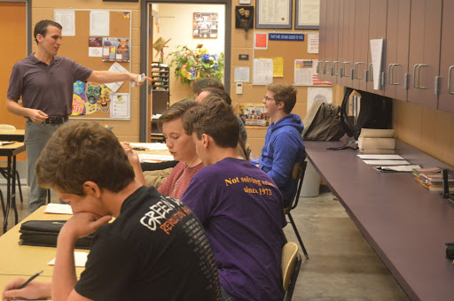 While the class works on an assignment Brett Buffum, theater teacher, laughs with Connor Salge, 10.