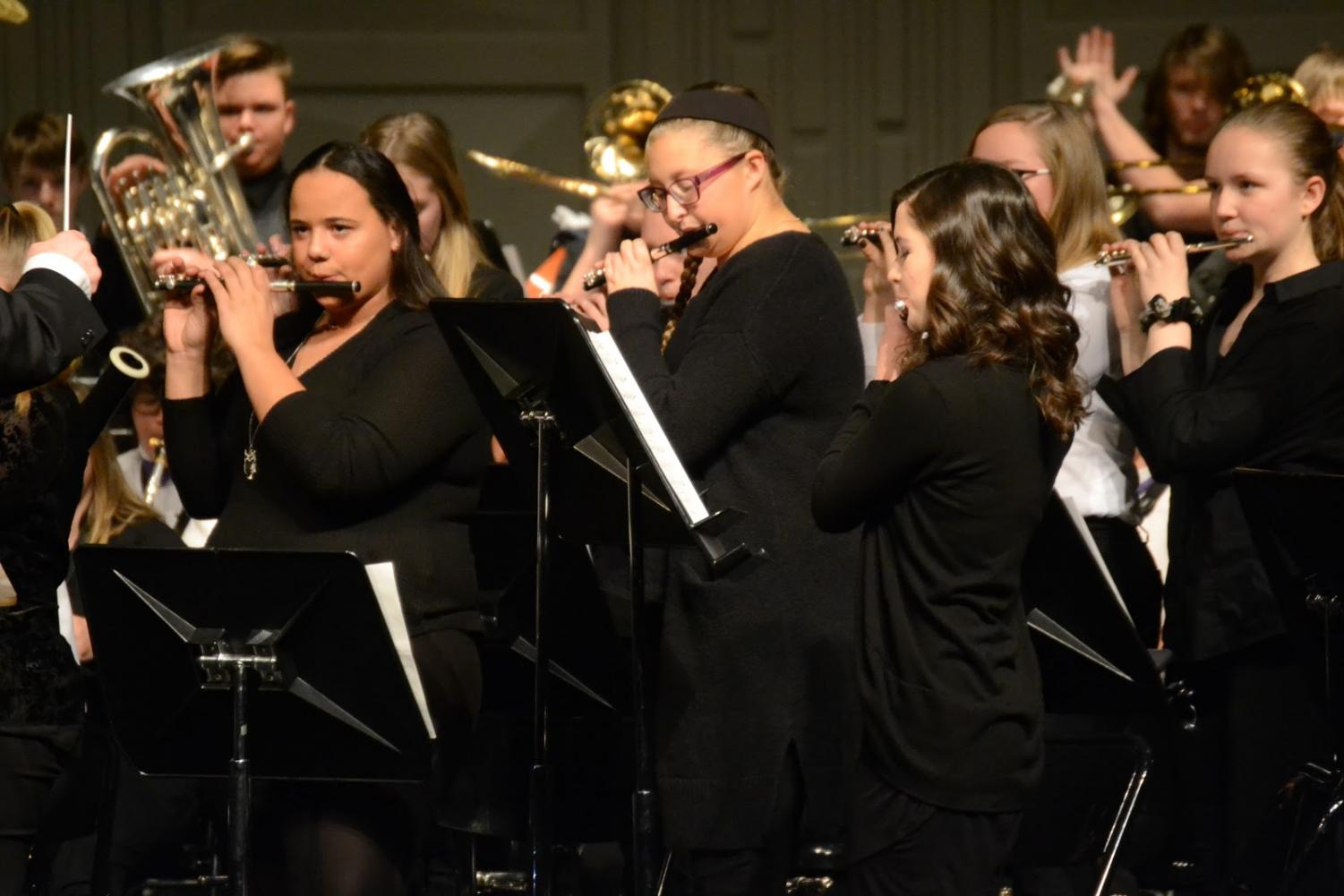 The flute section stands for their feature during the winter concert on Dec. 12.