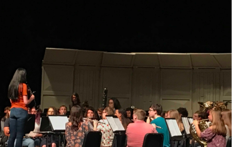 On May 8, before the main section of the concert begins Miranda Versaw, 12, stands in front of the band to tune the instruments.
