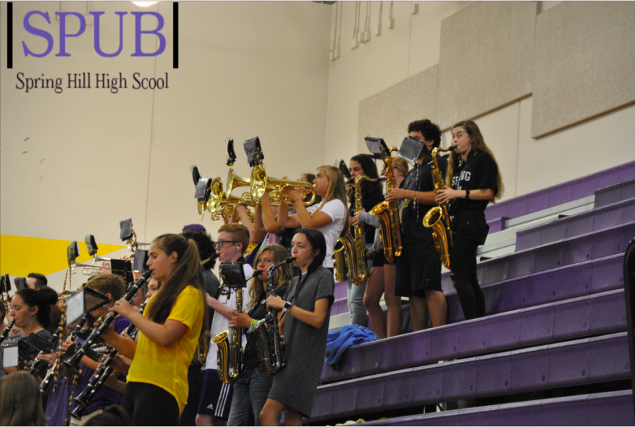 The brass and clarinets play pep songs during the pep assembly, on Aug. 19, to pep up the student body that is in the gym. The band prefects pep songs while also learning their marching show for the year. (Photo by ZKnust)