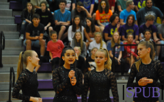 The dance team sets up their dance that they preformed during the pep assembly on Aug. 19. The dancers also hyped up the crowd dancing along to the pep songs played by the band at the beginning of the assembly. (Photo by ZKnust)