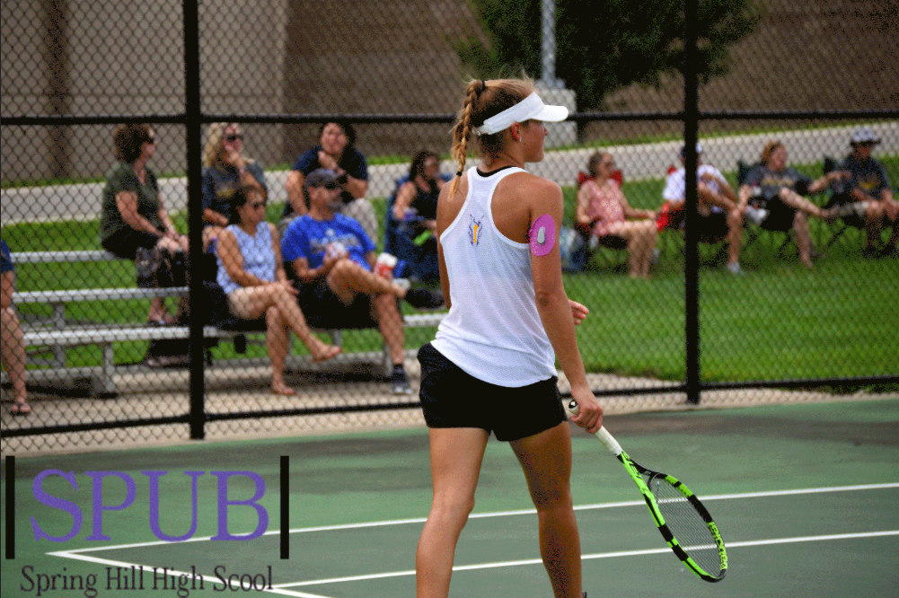 Izzy+Williams%2C+11%2C+finishes+her+single+against+Gardner.+Williams+went+3-0+and+took+first+place+at+singles.+%28Photo+by+L.Kuhn%29