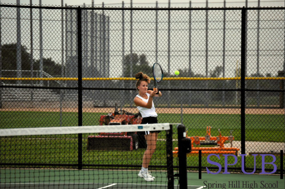 During+the+Home+Quad+on+Sept.+10+Avery+Copeland%2C+12%2C+servers+during+her+doubles+match+with+Katlyn+Pope%2C+12.+They+took+first+place+at+number+two+doubles.+%28Photo+by+L.Kuhn%29