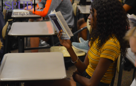 On Oct. 1 during 4th hour, Kadija Ceesay, 11, listens as Kelly Ediger, english teacher, reads