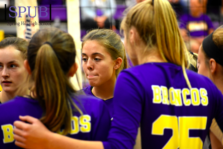 On Sept. 14 in their match against against the Loisburg team, the JV team discusses plans for winning the second set. Lindsay Hoffman, 11, stands with team mate Jenna Weber, 10. (Photo by IWilliams)