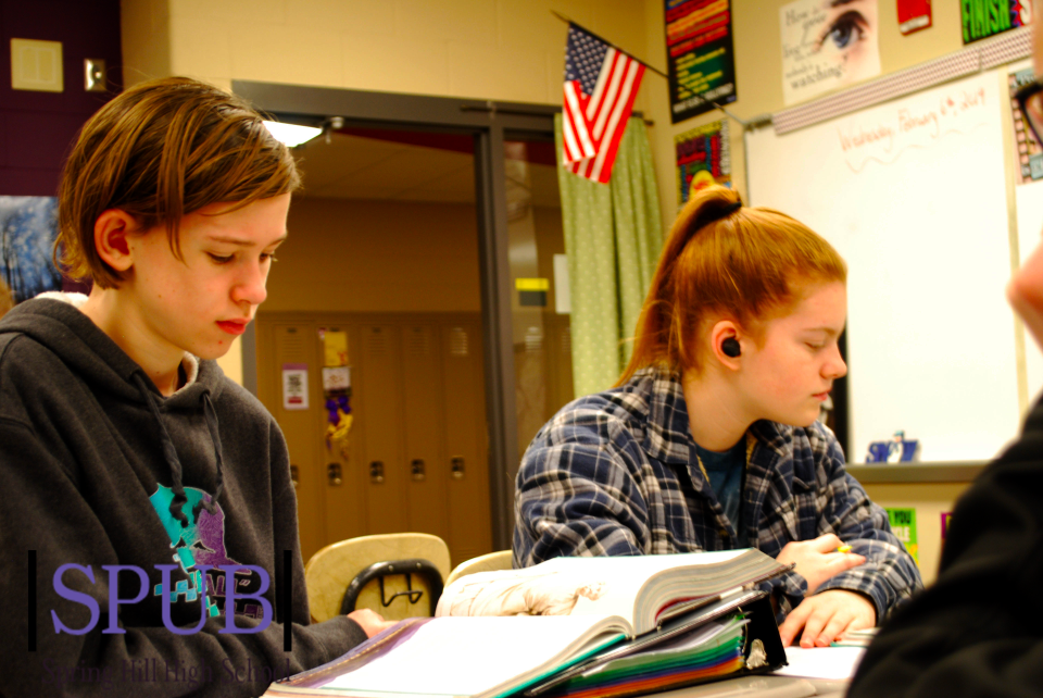 On Feb. 4, Zach Bradshaw, 10, and Cheyenne Kanakares, 10, prepare to read the Odyssey. Cheyenne also works at the Sonic. (photo credit T. Dent)