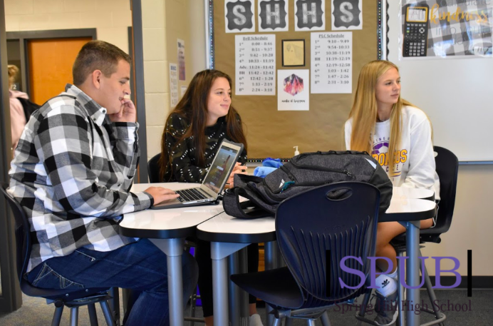 SADD officer Alec Hitchens,12, sitting with juniors Brianna Russo and Layla Smith. On Oct 9 2019, everyone who attended the meeting went over information about the SADD run and Red Ribbon week (photo by A.Hatfield).
