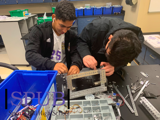 In Brent Smitheran's, robotics teacher, fourth hour robotics class, You Yang, 12, and Josh Santos, 12, are building a robot to run a course. They are improving their first design to have a much smoother run through the course (Photo by ZKnust).