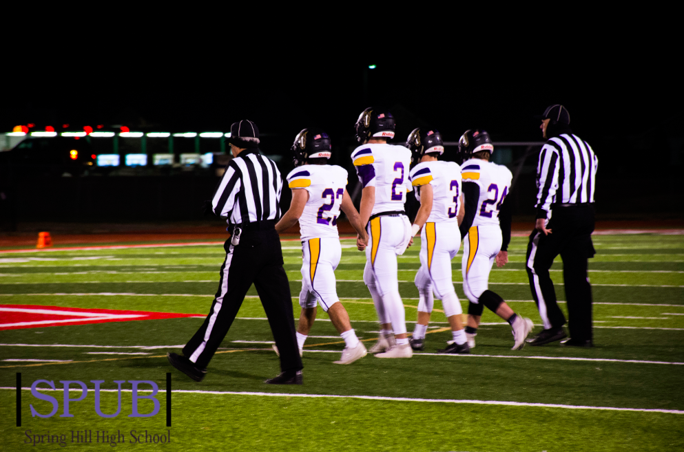 Team Captions, Zade Barker, 12, Corbyn Myers, 12, Hunter Wilyard, 12, and Jakob Stovall, 12 walk out for the coin flip. This would be the last coin flip of their senior year (Photo by AAnderson).