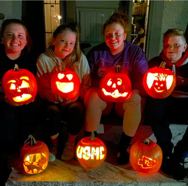 Posing+for+a+picture%2C+Kenzie+Rios%2C+12%2C+and+her+siblings+show+off+their+pumpkins.+The+pumpkin+in+the+middle+on+the+bottom+is+a+pumpkin+they+carved+for+their+brother+who+is+away+serving+in+the+military+%28Photo+submitted+by+Kenzie+Rios%29.%0A