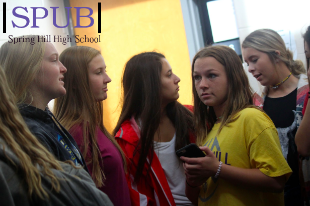 Sophomores Brooke Powell, Hannah McCormick, Kilee Castro, and Riahn Pinkerton talk to Tiktoker Tessa Dawson, 10 during Bronco Hour. They enjoy their friends company with or without her fame (photo by MHood).