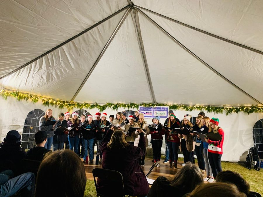 On+Dec.+7%2C+the+Madrigals+Sing+at+Crown+center+bringing+some+holiday+cheer+to+their+community.+This+was+just+one+stop+out+of+many+places+the+Madrigals+sang+at+this+holiday+season+%28Photo+Submitted+by+A.Waltrip%29.+
