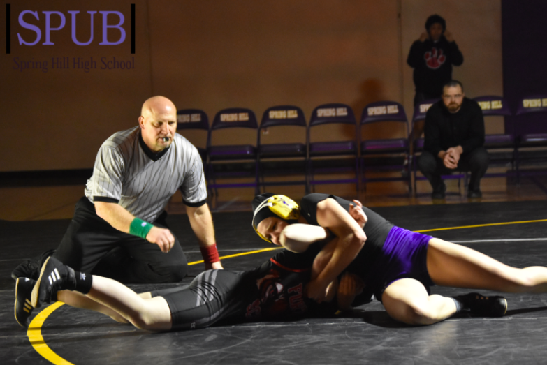 On+Jan.+31%2C+of+last+year%2C+Raegan+Stinemetz%2C+12%2C+wrestles+a+girls+from+Fort+Scott.+Stinemetz+is+wrestling+again+this+year+%28Photo+by+MRiddle%29.+