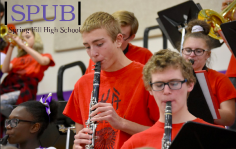 The clarinet section hard at work entertaining at a home basketball game. The pep band plays at all home basketball and football games. (Photo by A. Frigon).