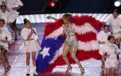 "For the 54th Super Bowl Jennifer Lopez and daughter Emme Maribel Muniz preform together. Lopez's daughter sang ""Born in the USA,' while her along with other children emerged from what seemed to be cages (Photo Courtesy of AP Photo and Charlie Riedel)."