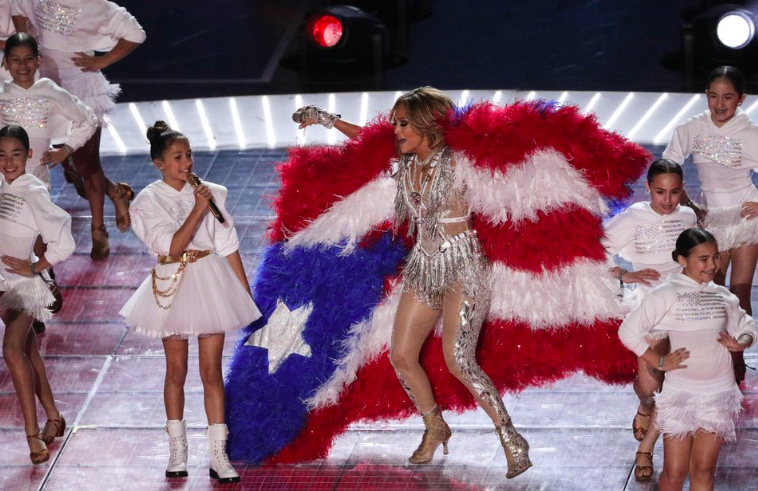 """For the 54th Super Bowl Jennifer Lopez and daughter Emme Maribel Muniz preform together. Lopez's daughter sang """"Born in the USA,' while her along with other children emerged from what seemed to be cages (Photo Courtesy of AP Photo and Charlie Riedel)."""