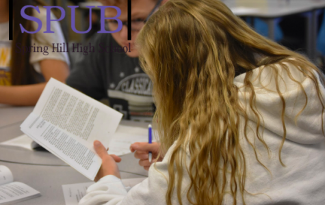"""In her Honors English Class, Alyssa Anderson, 10, reads """"Twelve Angry Men."""" The six Kan. state schools have changed the way that they're doing admissions, and it may affect what classes people choose to take (photo by ADavis)."""