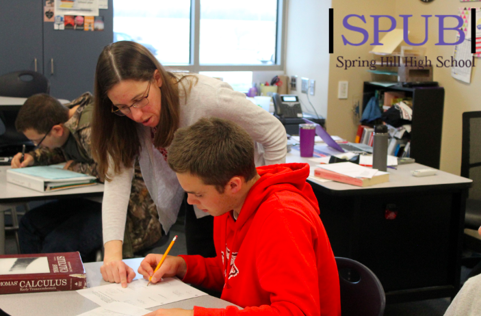 On March 23, 2019, Tyler North works on his Calculus, a College now course,  homework while Karla DeCoster, Calculus teacher,  helps him. North took decided to take Calculus his Junior year (photo by TDent).