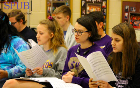 During Georann Witman's 4th hour Madrigals class, on April 26, 2019 Avery Copeland, 11, Maya Sosa, 11, and Abby Waltrip, 11, rehearse their parts for the opening number. Their concert was on May 9th, 2019 (photo by A. Mattox).