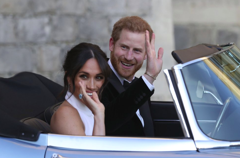 On May 19, 2019, the newly married and former Duke and Dutchess of Sussex, Prince Harry and Meghan in a convertible car after their wedding. They have since decided to leave the royal family (Photo courtesy by AP Photo).