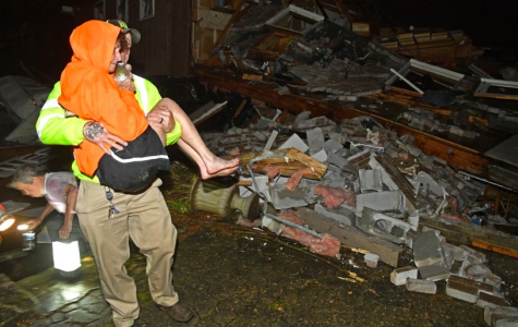 On March 3, after tornados ripped through Tennessee a resuce worker caries Shirley Wallace from her home that collapsed and trapped her under rubble. Tornados become a higher risk come the begging of spring (Photo Courtesy of The Tennessean via AP Photo and Larry McCormack).