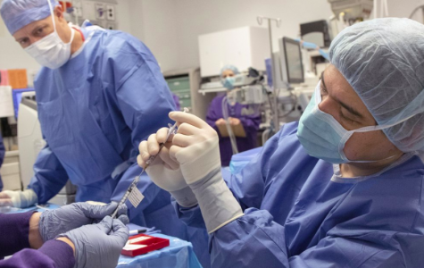 On Wed. 4, Dr. Andreas Lauer prepares for his first ever CRISPER surgury. With Advances in CRISPER certain types of blindness become more curable (Photo Courtesy of OHSU via AP and Kristyna Wentz-Graff).