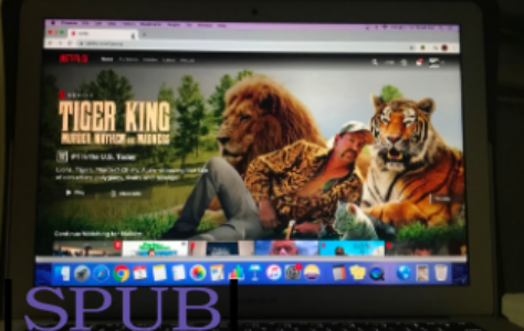"When you open Netflix, this is the first thing you see. ""#1 in the U.S Today"" along with Joe Exotic, the main character, posing with a few of his big cats. It then plays a short preview of the series, grabbing the viewer's attention (Photo by M. Putnam)."
