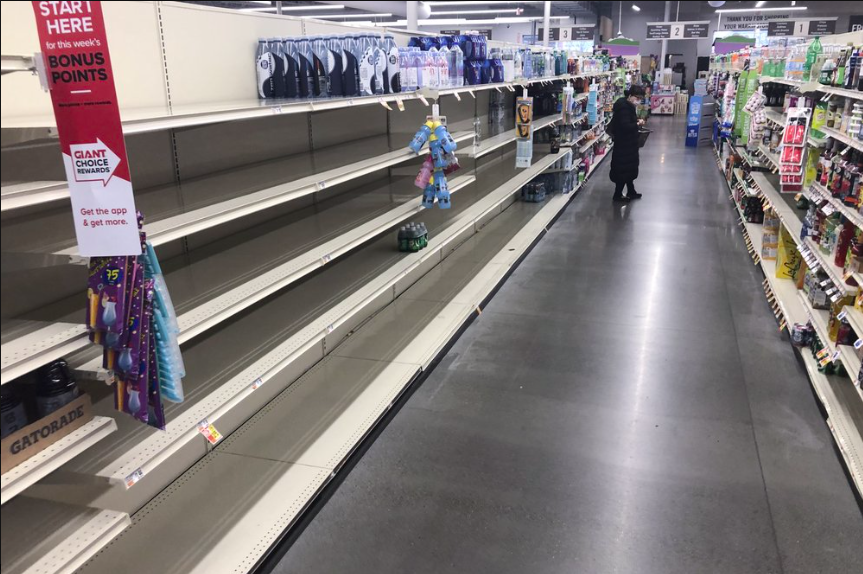 This Pennsylvania grocery store's shelves are becoming a common sight in stores all across the country, as panic buying due to COVID-19 continues (photo courtesy of AP News).