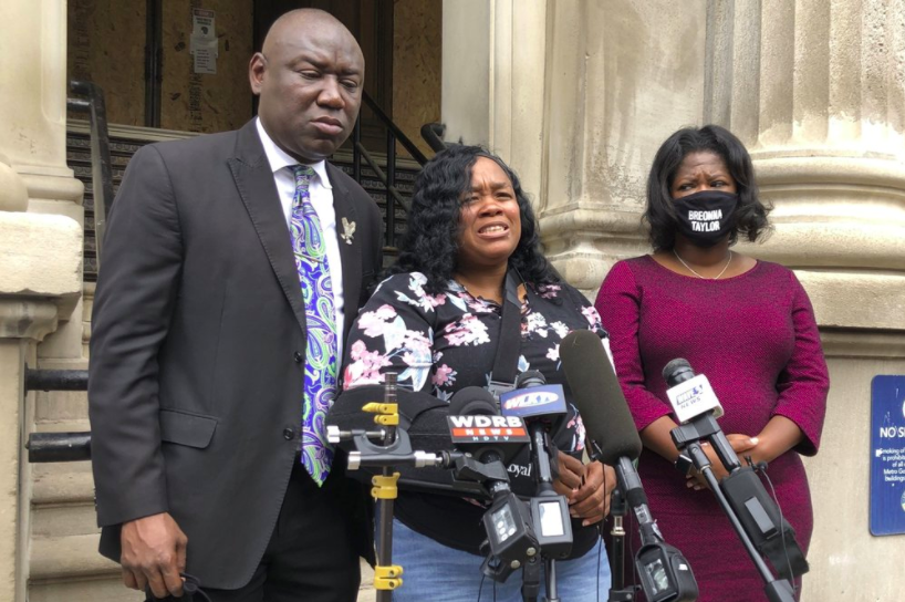 Breonna Taylor's mother, Tamika Palmer, addresses the media on August 13. Palmer will receive $12 million dollars in a settlement for a lawsuit she filed against the city of Louisville (photo courtesy of AP News).