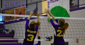 On Sept. 14, 2019, Jenna Weber, 10, and Jordan Anderson, 11, jump to block a ball against Louisburg. The first positive coronavirus case was contracted by a volleyball player, but there is no evidence to say that is where she contracted it (Photo by I. Williams).