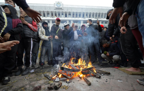 Protestors gathered in front of Kyrgyzstan's governmental building to express their discontent with the election (photo credit AP News).