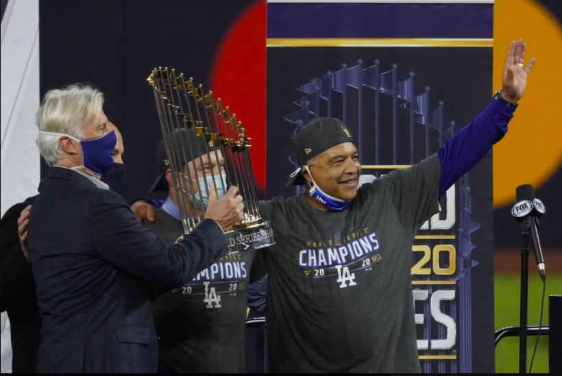LA Dodgers manager Dave Roberts poses with the World Series trophy. He led the Dodgers to victory, ending the 30-year championship drought (photo courtesy AP News).