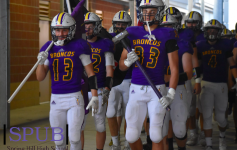 Varsity football boys get ready to run onto the field and play against the Bonner Springs Braves. Zach Knowlton, 11, and Chase Wilm, 12, were in the front with the brotherhood flag and hammer (photo credit A. Davis).