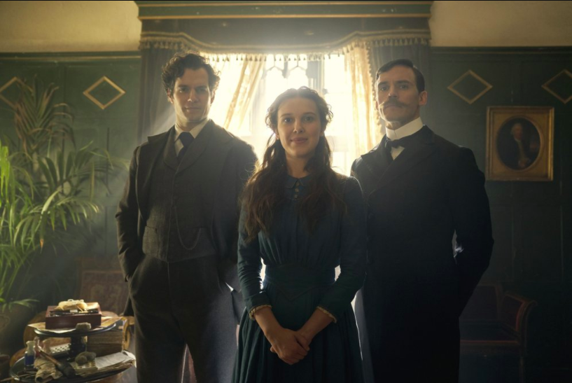 Enola Holmes, standing in front of her two older brothers, Sherlock and Mycroft. Enola Holmes is a new Netflix Original Film starring Milly Bobby Brown as Enola, the main character (photo courtesy AP News).
