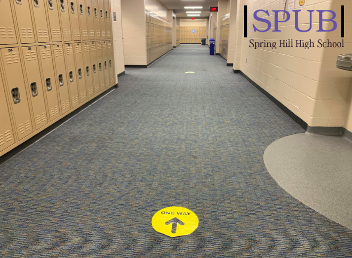 """One way"" signs can be seen everywhere throughout the hallways of school, making hallways less crowded and easier to distance (photo credit O. Leblanc)."