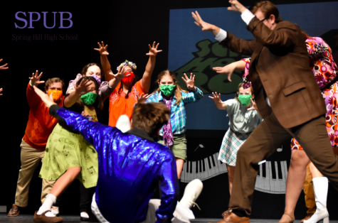 """In the song """"Ready or Not,"""" Remington White, 10, is startled by the rest of the cast while playing a fake game of hide and seek. The show follows the story of Tom, a new teacher who is performing Schoolhouse Rock songs in preparation for the first day of school (photo credit K. Oakes)."""