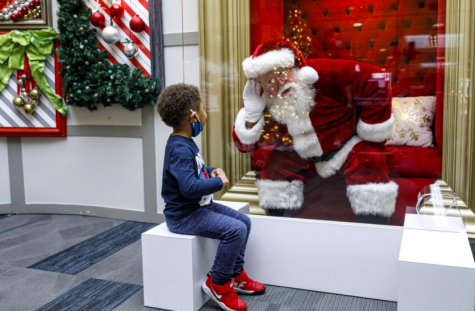 The Capital City Mall in Pennsylvania is another business who found a unique way to adapt traditions changed by COVID-19. Their Santa Claus sits behind a wall of plexiglass to speak with children, making sure everyone stays safe while still experiencing the magic of the holidays (photo courtesy AP News).