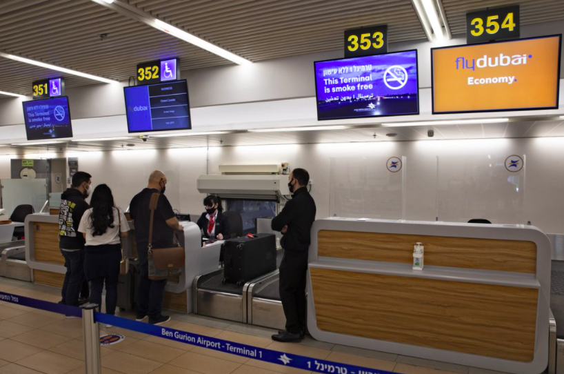 On Dec. 3, these Israeli citizens prepared to board a plane to Dubai. The Israeli government has urged citizens to avoid all travel to the UAE and Iran (photo credit AP News).