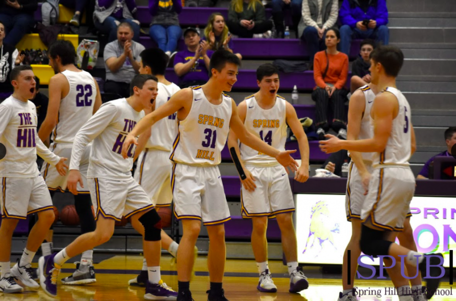 On Feb. 28, 2020 the Boys Varsity basketball team cheered after a basket was made. This season, however, they won't be bolstered with the same level of cheers from the crowd (photo credit O. Lawson).