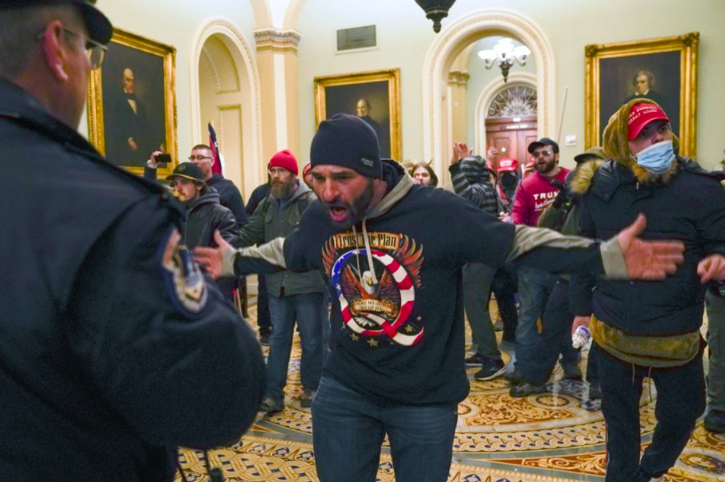 On Jan. 6, a man yells at a Capitol police officer stopping him from forcefully entering the Senate chamber. This man is one of hundreds that stormed the Capitol, hoping to disrupt the vote count that would certify President-elect Joe Biden