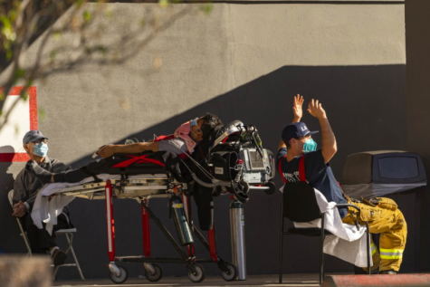 At this California hospital, there is no space to take on more patients, leading those who need care like this man to receive oxygen and other life-saving resources outside the building. While this is a large issue in L.A., cities across the country are facing this problem (photo courtesy AP News).