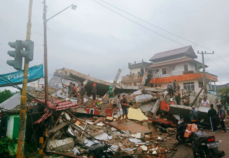 15,000 people have been displaced due to mass destruction caused by an earthquake in Indonesia. The country is in a state of emergency (photo courtesy AP News).