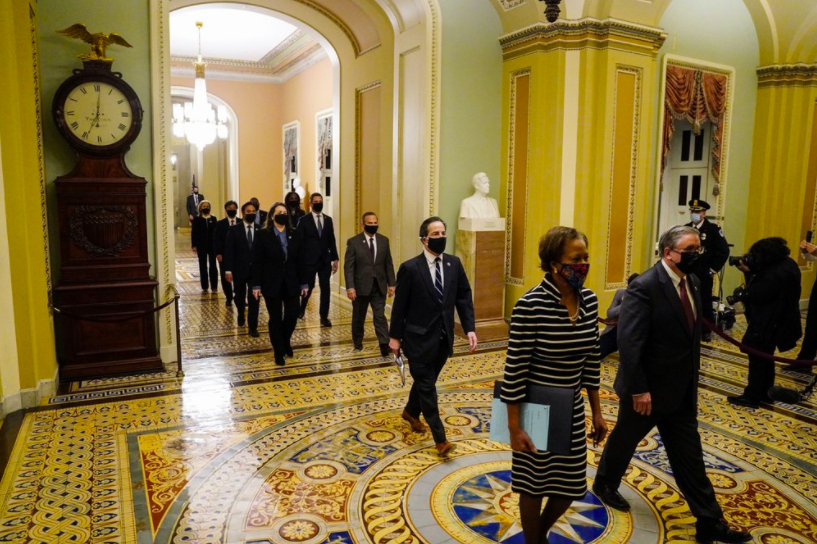 On Jan. 25, clerk of the House Cheryl Johnson and acting House Sargeant-at-Arms Tim Blodgett led the impeachment managers to the Senate floor. The article of impeachment brought against Donald Trump has officially been delivered (photo courtesy AP News).