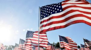 American flags are lined up to symbolize the unity the country needs (photo courtesy of NPR).