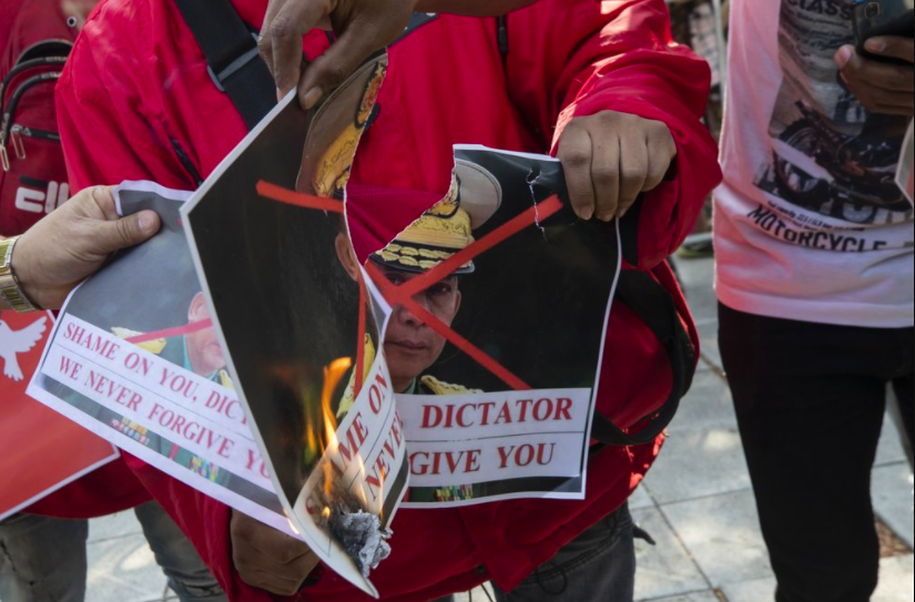 At a protest in front of a United Nations building in Thailand, Myanmar nationals set fire to a photo of Commander-in-Chief Senior Gen. Min Aung Hilang. The situation in Myanmar is increasingly unstable after a military coup in early February (photo courtesy AP News).