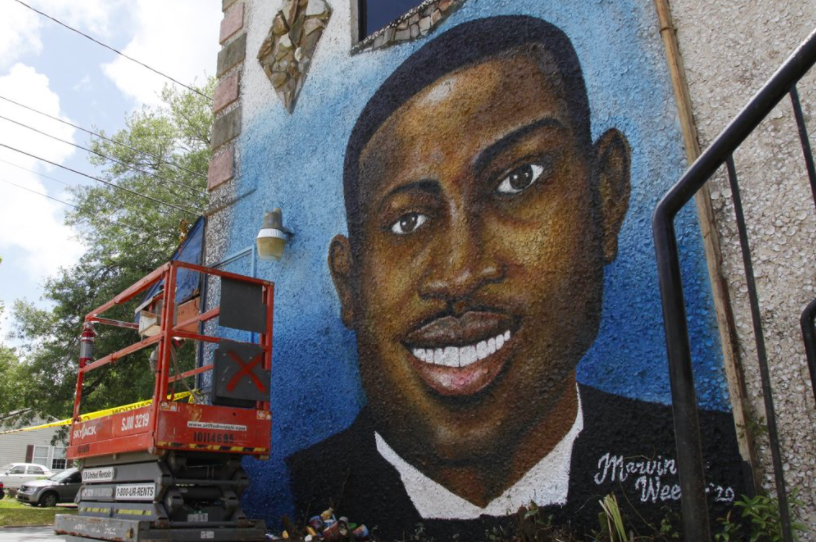 A mural by artist Marvin Weeks in honor of Ahmaud Arbery. Feb. 23 marks the one-year anniversary of the runner's murder at the hands of two white men who pursued him as he was on a run (photo courtesy AP News).