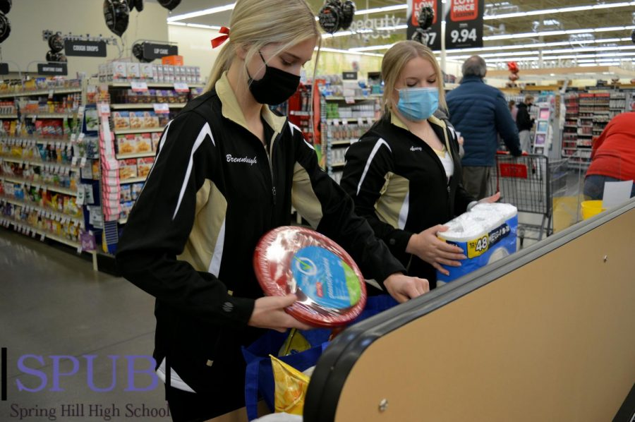 On Feb. 6, Brennleigh Towles, 12, and Avery Marney, 11, sack groceries for the Dazzler Dance Team. The Dance Team worked for two days to raise money toward their Nationals trip in the Spring (Photo by A. Marney).