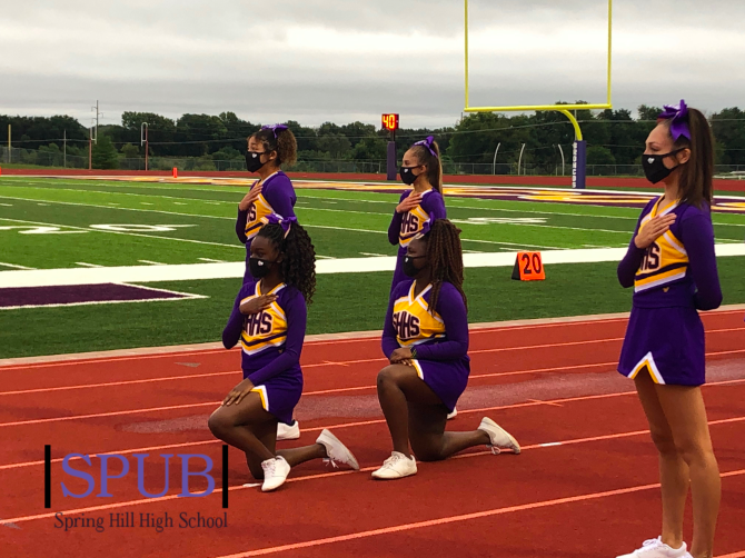 Lauren Gachanja, 9, and Sylvia Thaithi, 10, kneel during the national anthem before a football game. Different forms of protesting have become more prevalent in recent months, as the Black Lives Matter movement has gained nationwide attention; students at Spring Hill talked about how they felt about the movement (photo submitted by G. Roberts).